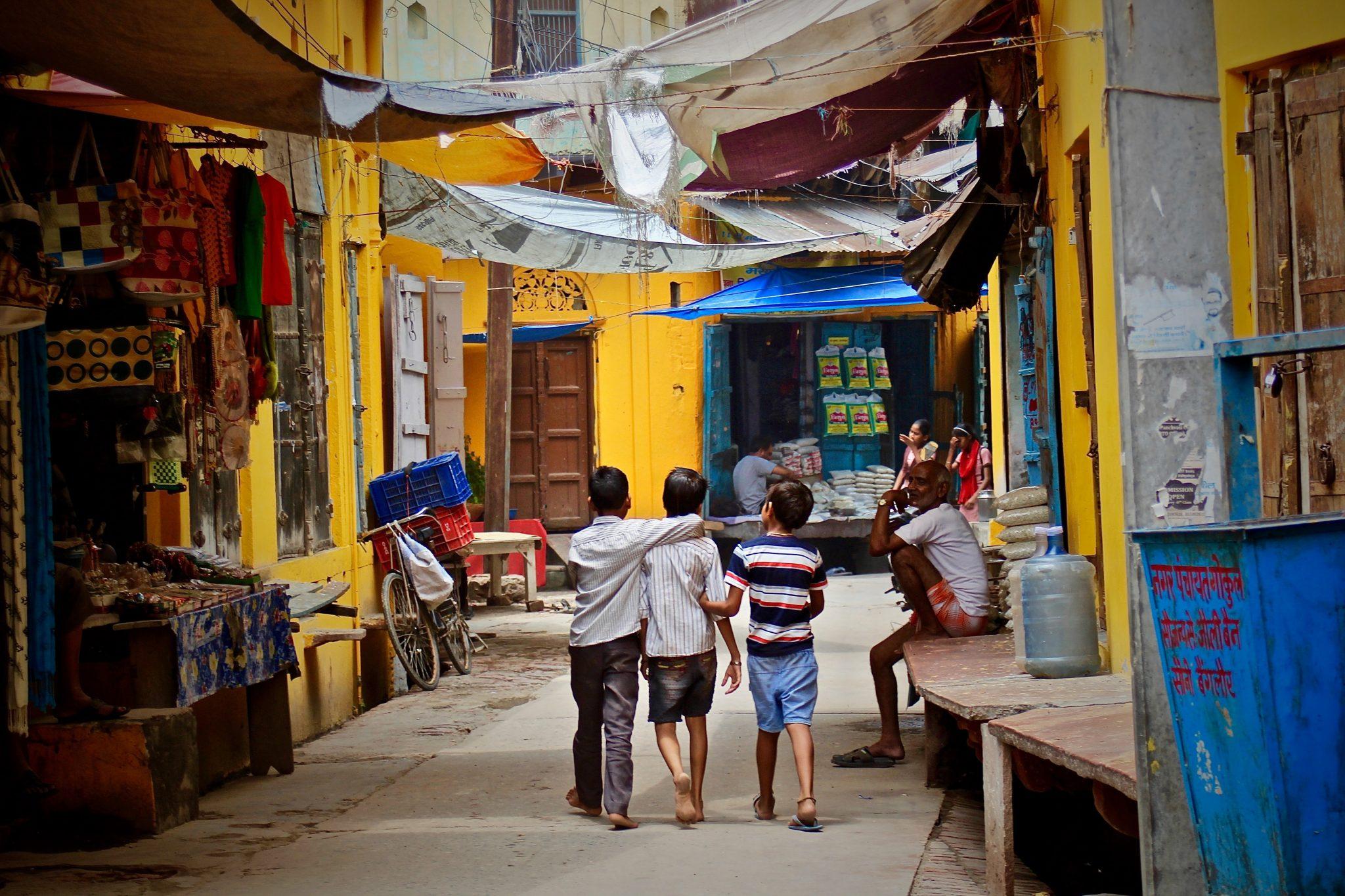 Three boys walking in the street