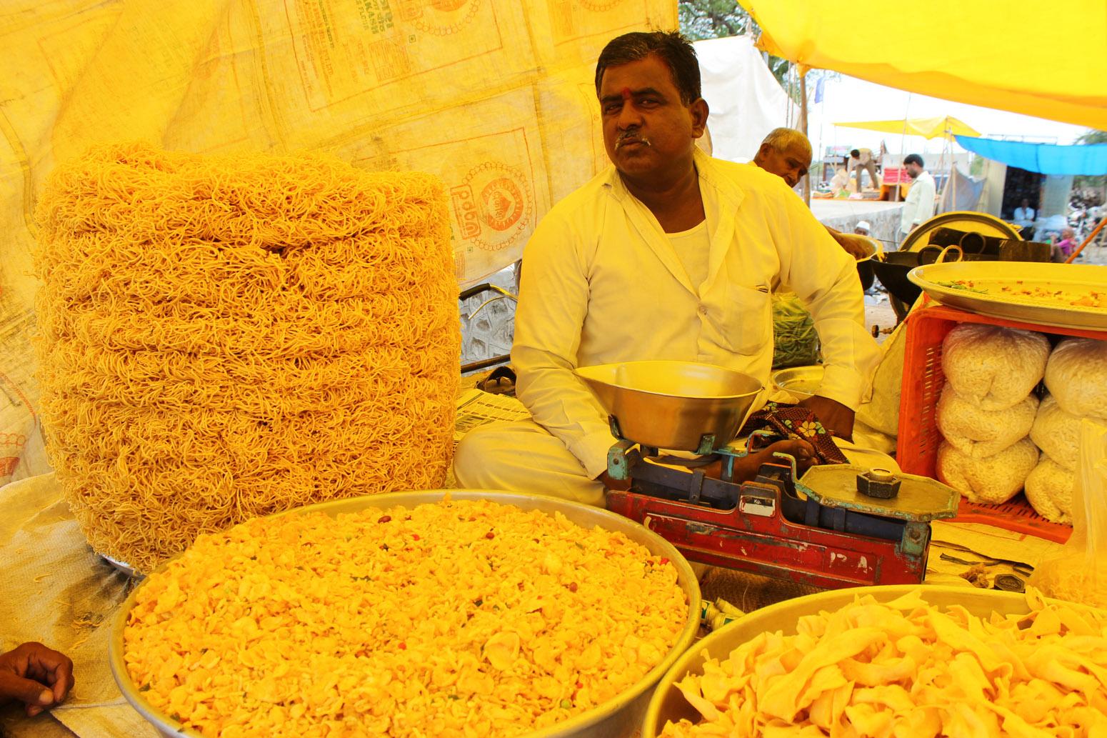 man selling food at market