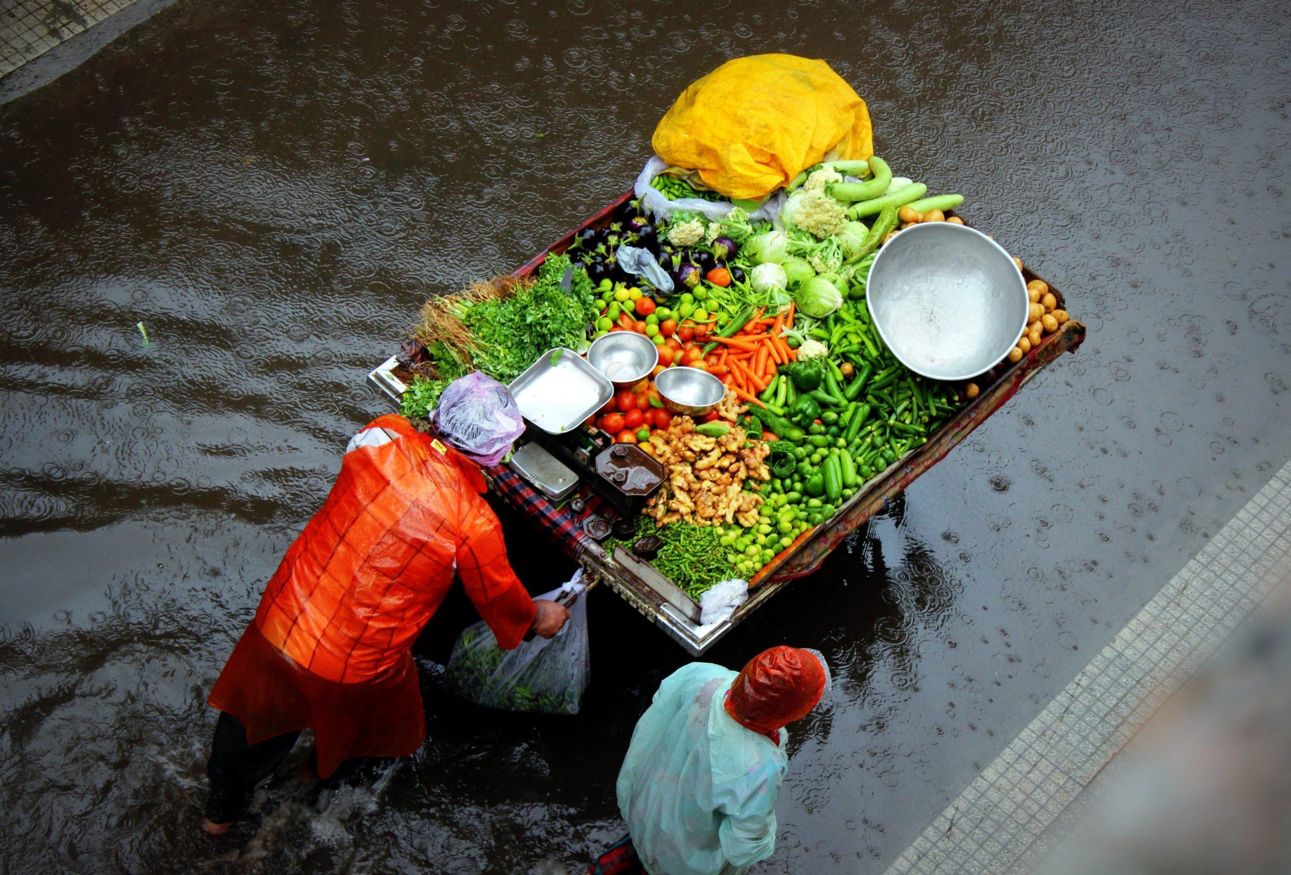 two people pushing food cart