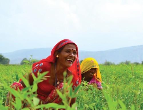 women smiling in field
