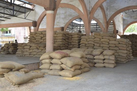 stacks of burlap food bags