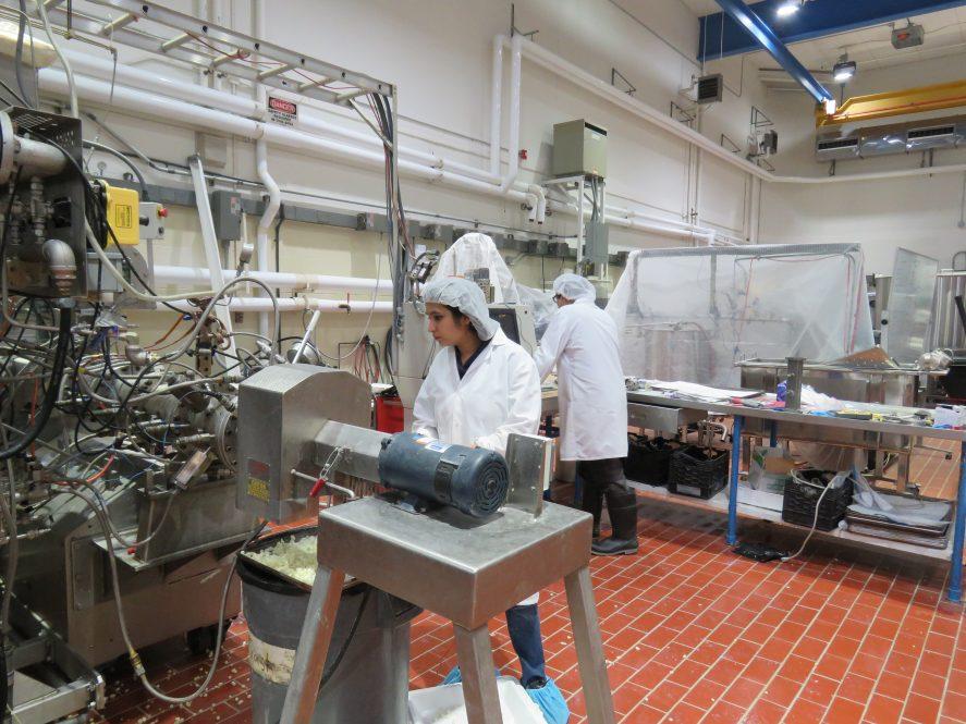 Bindvi Arora standing behind an extruder machine
