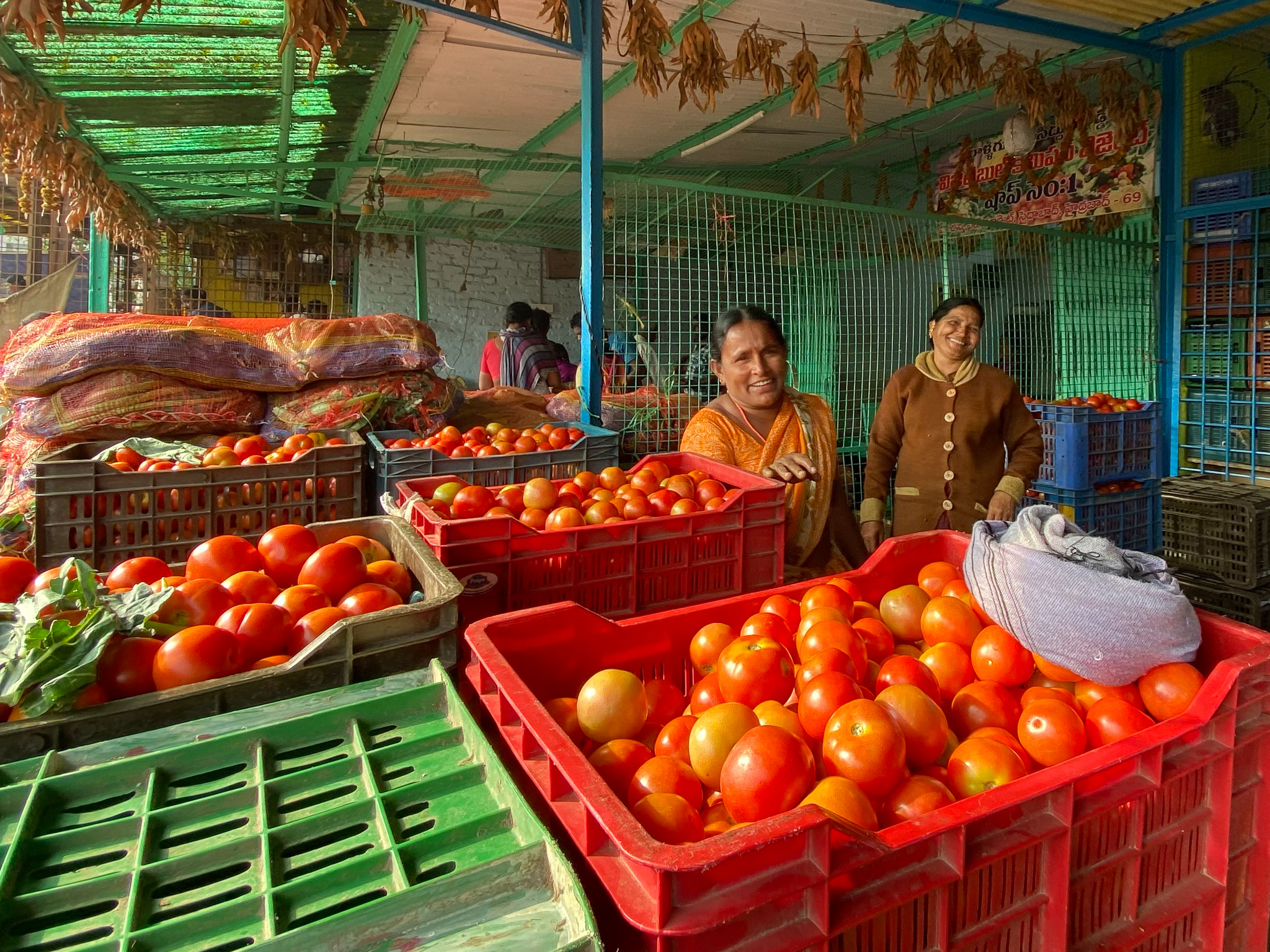 Two women selling tomatoes